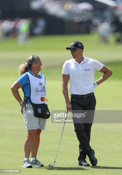 Henrik Stenson of Sweden waits to play his second shot on the par 4 first hole with his caddie Fanny Sunesson of Sweden during the final round of the...