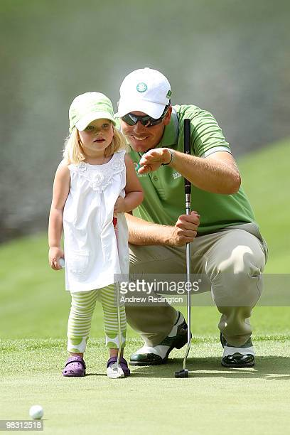 Henrik Stenson of Sweden waits with his daughter Lisa during the Par 3 Contest prior to the 2010 Masters Tournament at Augusta National Golf Club on...