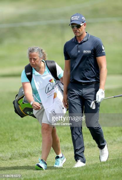 Henrik Stenson of Sweden walks off the tee with his caddie Fanny Sunesson of Sweden on the par 3 14th hole during the third round of the 2019 Arnold...