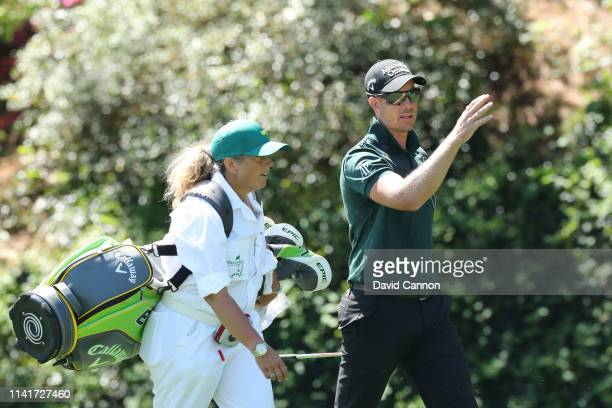 Henrik Stenson of Sweden walks with caddie Fanny Sunesson during a practice round prior to the Masters at Augusta National Golf Club on April 10 2019...