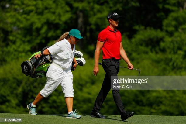 Henrik Stenson of Sweden walks with caddie Fanny Sunesson on the 12th hole during the second round of the Masters at Augusta National Golf Club on...
