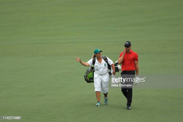 Henrik Stenson of Sweden walks with caddie Fanny Sunesson on the second hole during the second round of the Masters at Augusta National Golf Club on...
