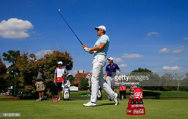 Henrik Stenson of Sweden watches his tee shot on the seventh hole during the second round of the TOUR Championship by CocaCola at East Lake Golf Club...