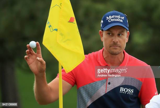 Henrik Stenson of Sweden waves after holing a bunker shot on the seventh hole during the third round of the 2018 Masters Tournament at Augusta...
