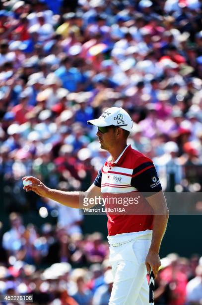 Henrik Stenson of Sweden waves after putting on the 18th green during the first round of The 143rd Open Championship at Royal Liverpool on July 17...