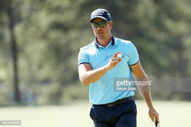 Henrik Stenson of Sweden waves on the 17th hole during the first round of the 2018 Masters Tournament at Augusta National Golf Club on April 5 2018...