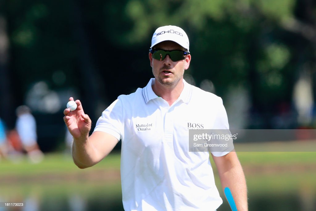 Henrik Stenson of Sweden waves to the gallery after a birdie on the sixth hole during the first round of the TOUR Championship by Coca-Cola at East Lake Golf Club on September 19, 2013 in Atlanta, Georgia.