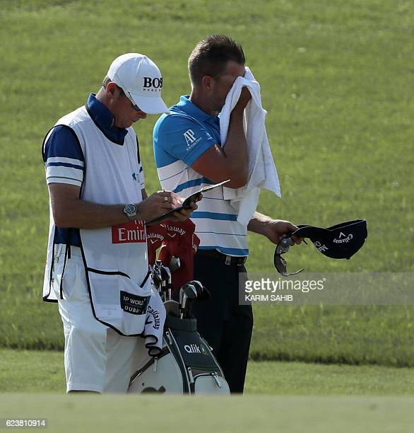 Henrik Stenson of Sweden wipes his face during day one of the DP World Tour Championship at Jumeirah Golf Estates on November 17 2016 in Dubai The...