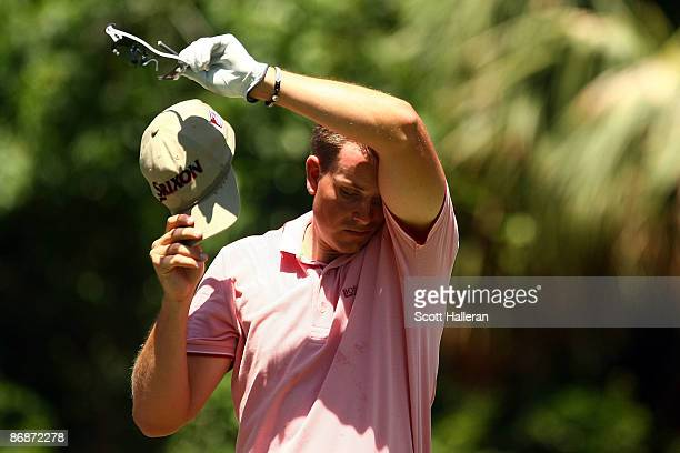 Henrik Stenson of Sweden wipes sweat from his face on the second hole during the third round of THE PLAYERS Championship on THE PLAYERS Stadium...