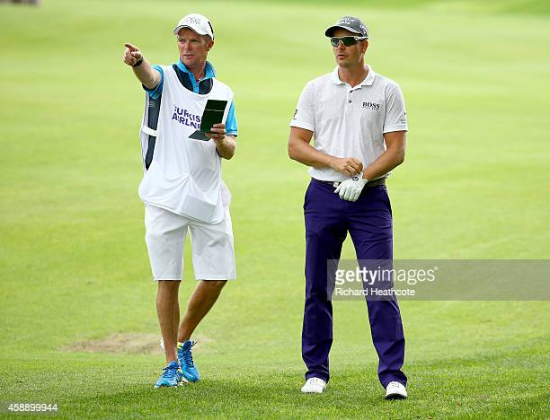 Henrik Stenson of Sweden with caddy Gareth Lord during the first round of the 2014 Turkish Airlines Open at The Montgomerie Maxx Royal on November 13...