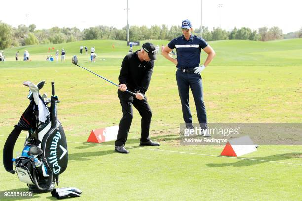 Henrik Stenson of Sweden works with his coach Pete Cowen on the range prior to the Abu Dhabi HSBC Golf Championship at Abu Dhabi Golf Club on January...