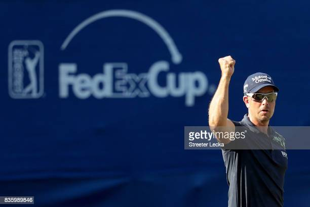 Henrik Stenson reacts after making a putt on the 17th hole during the final round of the Wyndham Championship at Sedgefield Country Club on August 20...