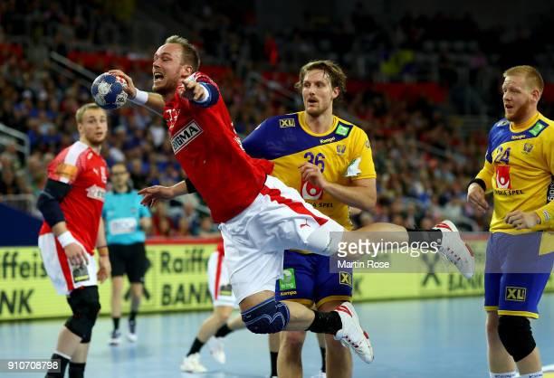 Henrik Toft Hansen of Denmark challenges Jesper Nielsen of Sweden during the Men's Handball European Championship semi final match between Denmark...