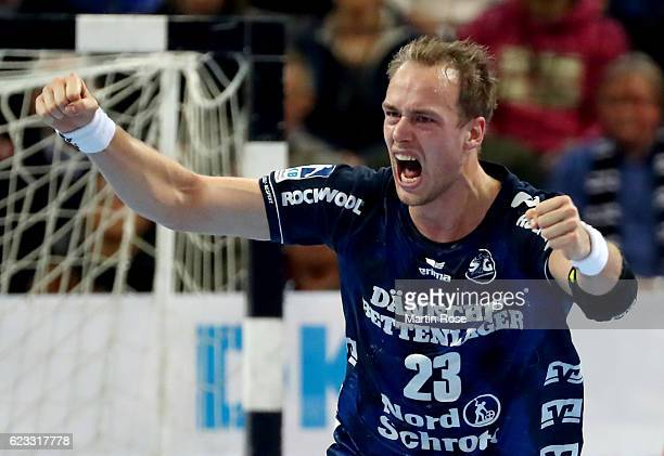Henrik Toft Hansen of FlensburgHandewitt celebrates after scoring during the DKB HBL Bundesliga match between THW Kiel and SG FlensburgHandewitt at...