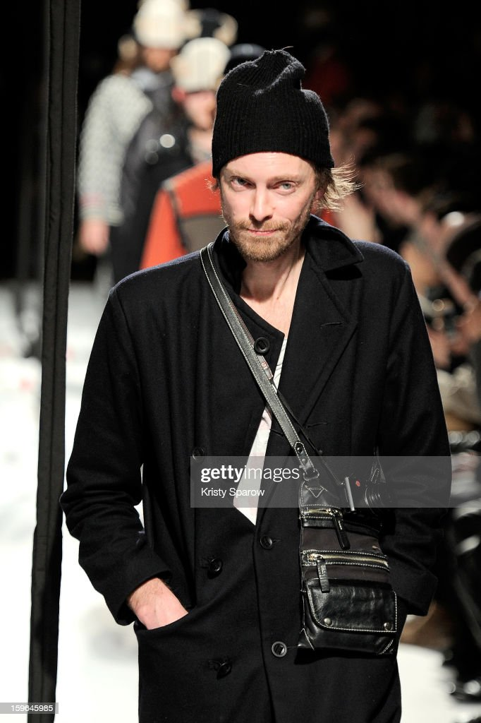 Henrik Vibskov acknowledges the public following the Henrik Vibskov Men Autumn / Winter 2013/14 show as part of Paris Fashion Week on January 17, 2013 in Paris, France.