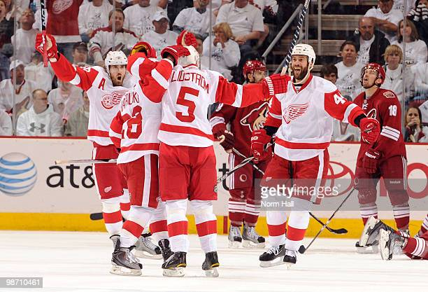 Henrik Zetterberg and Todd Bertuzzi of the Detroit Red Wings celebrate with teammates after a goal against the Phoenix Coyotes in Game Seven of the...