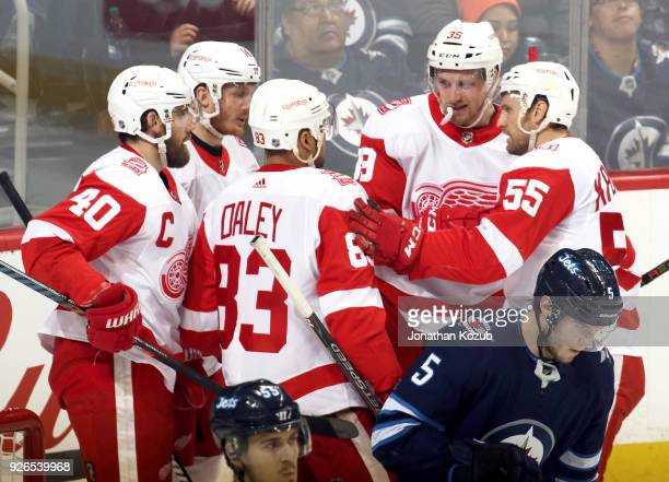 Henrik Zetterberg Gustav Nyquist Trevor Daley Anthony Mantha and Niklas Kronwall of the Detroit Red Wings celebrate a second period goal against the...