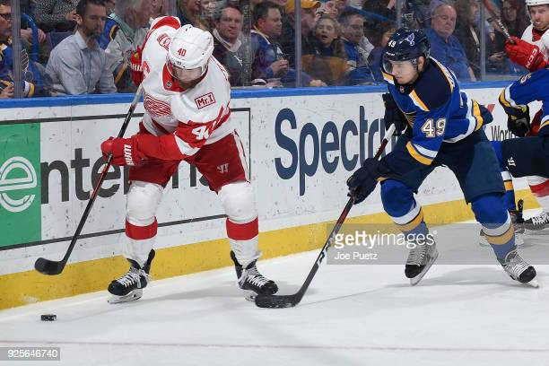 Henrik Zetterberg of the Detroit Red Wings and Ivan Barbashev of the St Louis Blues battle for the puck at Scottrade Center on February 28 2018 in St...