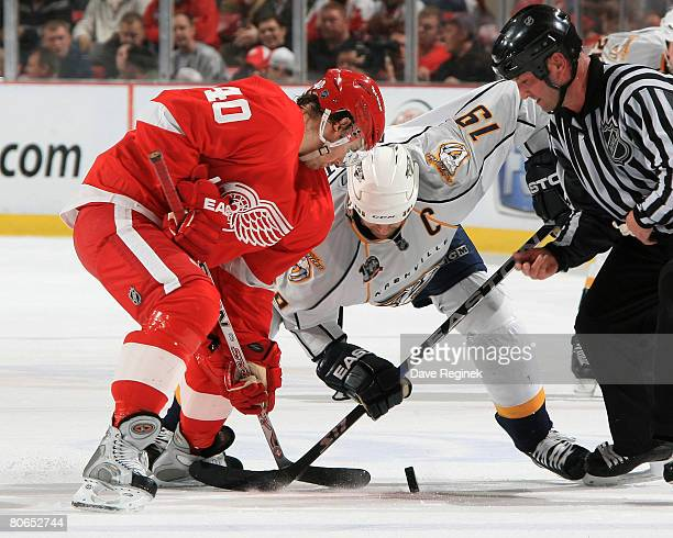 Henrik Zetterberg of the Detroit Red Wings and Jason Arnott of the Nashville Predators fight for the dropped puck during game two of the 2008 NHL...