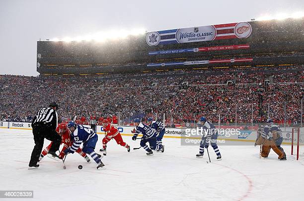 Henrik Zetterberg of the Detroit Red Wings and Nazem Kadri of the Toronto Maple Leafs face off during the 2014 Bridgestone NHL Winter Classic at...