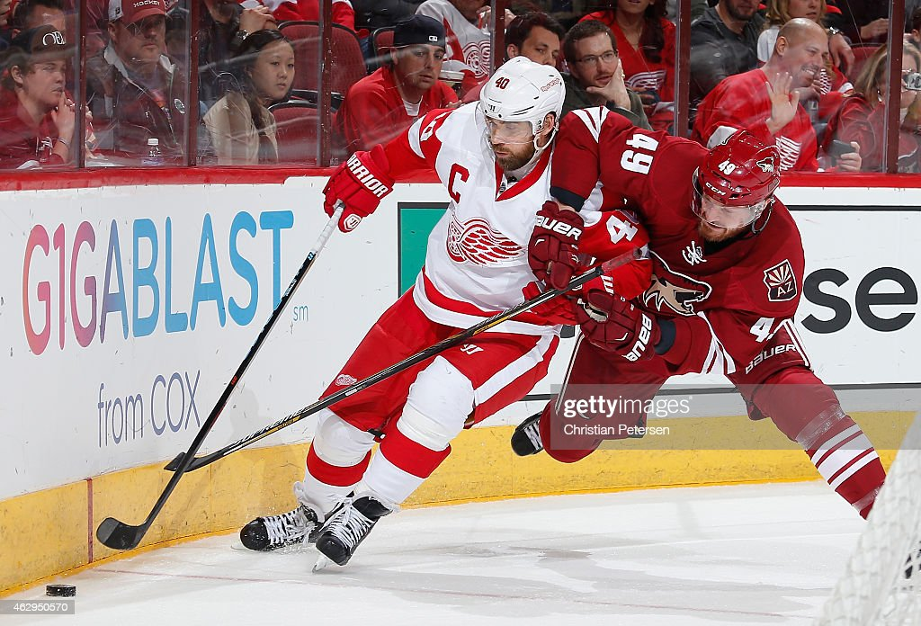 Henrik Zetterberg #40 of the Detroit Red Wings battles with Alex Bolduc #49 of the Arizona Coyotes as he attempts to control the puck during the third period of the NHL game at Gila River Arena on February 7, 2015 in Glendale, Arizona.