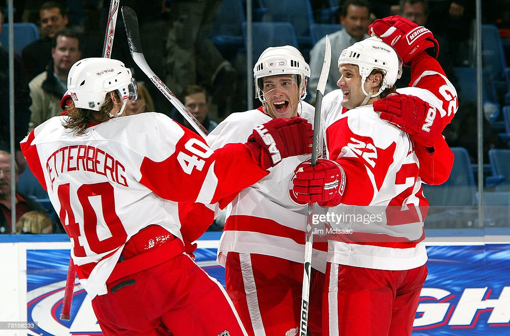 Henrik Zetterberg #40 of the Detroit Red Wings celebrates his overtime goal against the New York Islanders with teammates Pavel Datsyuk #13 and Brett Lebda #22 on January 30, 2007 at Nassau Coliseum in Uniondale, New York.