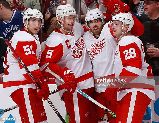 Henrik Zetterberg of the Detroit Red Wings celebrates his overtime winning goal with teammates Valtteri Filppula Nicklas Lidstrom and Brian Rafalski...