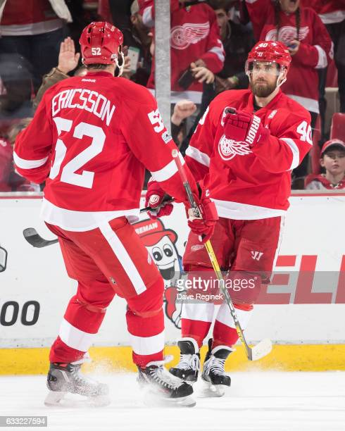 Henrik Zetterberg of the Detroit Red Wings celebrates his second period goal with teammate Jonathan Ericsson during an NHL game against the New...