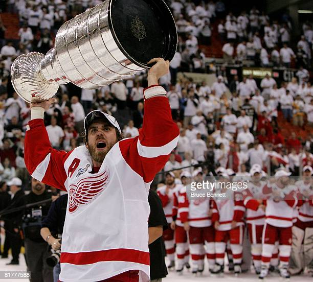 Henrik Zetterberg of the Detroit Red Wings celebrates with the Stanley Cup after defeating the Pittsburgh Penguins in game six of the 2008 NHL...