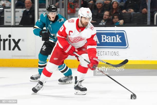 Henrik Zetterberg of the Detroit Red Wings controls the puck ahead of Marcus Sorensen of the San Jose Sharks at SAP Center on March 12 2018 in San...