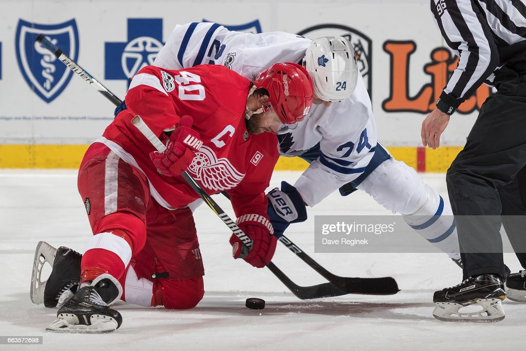 Henrik Zetterberg #40 of the Detroit Red Wings faces off against Brian Boyle #24 of the Toronto Maple Leafs during an NHL game at Joe Louis Arena on April 1, 2017 in Detroit, Michigan. The Leafs defeated the Wings 5-4.
