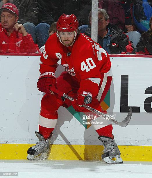 Henrik Zetterberg of the Detroit Red Wings flipe the puck in a game against the Minnesota Wild on December 7 2007 at the Joe Louis Arena in Detroit...