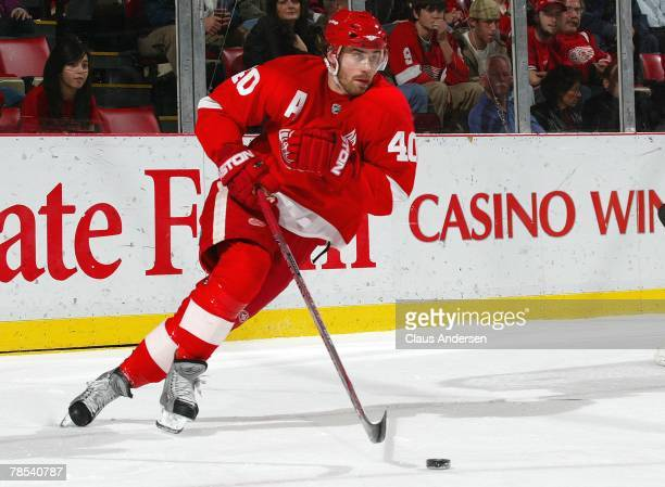 Henrik Zetterberg of the Detroit Red Wings heads up ice with the puck in a game against the Minnesota Wild on December 7 2007 at the Joe Louis Arena...