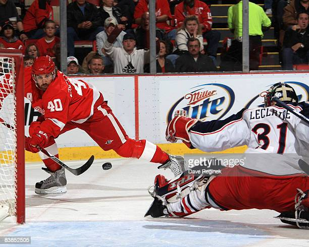 Henrik Zetterberg of the Detroit Red Wings hits the post as he shoots the puck past goalie Pascal Leclaire of the Columbus Blue Jackets during a NHL...