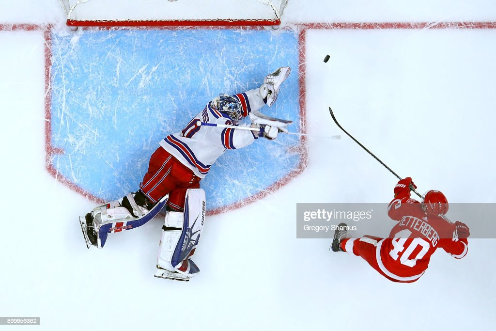 Henrik Zetterberg #40 of the Detroit Red Wings misses a shootout attempt on Henrik Lundqvist #30 of the New York Rangers at Little Caesars Arena on December 29, 2017 in Detroit, Michigan. Detroit won the game 3-2 in a shootout.