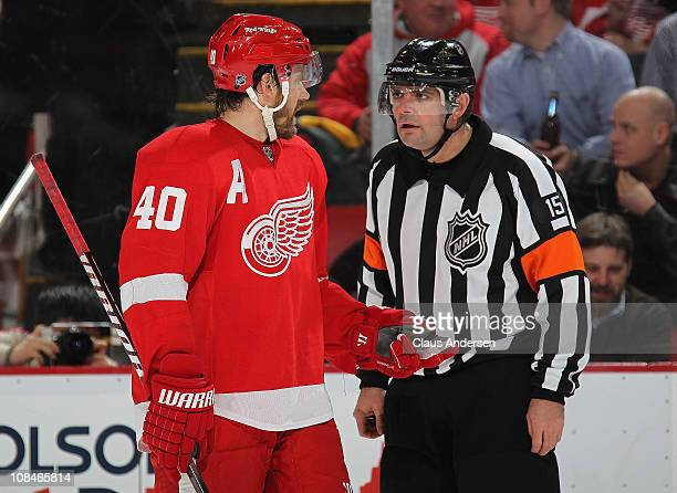 Henrik Zetterberg of the Detroit Red Wings questions referee Stephane Auger about a play in a game against the New Jersey Devils on January 26 2011...