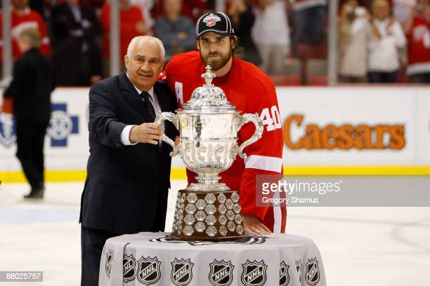 Henrik Zetterberg of the Detroit Red Wings recieves the Clarence S Campbell Bowl from NHL Senior Vice President of Hockey Operations Jim Gregory...