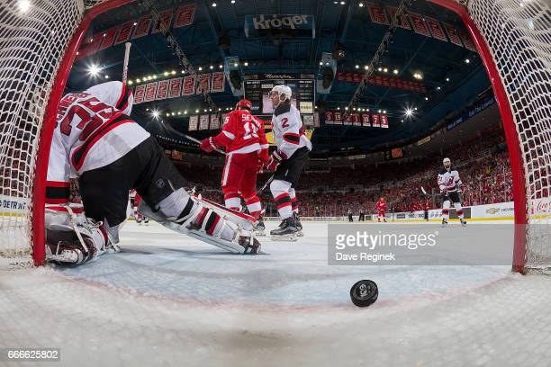 Henrik Zetterberg of the Detroit Red Wings scores a second period goal on Cory Schneider of the New Jersey Devils during an NHL game at Joe Louis...