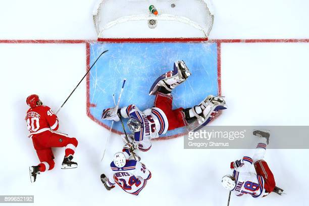 Henrik Zetterberg of the Detroit Red Wings scores a third period goal past Henrik Lundqvist of the New York Rangers at Little Caesars Arena on...