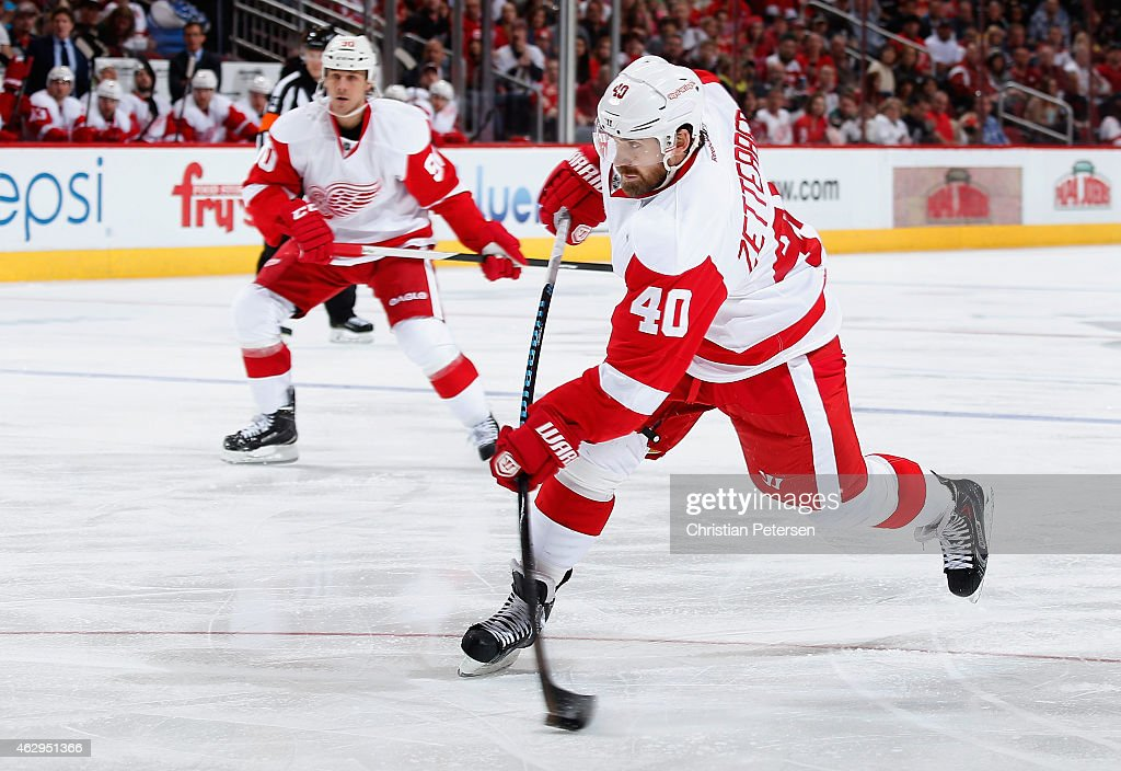 Henrik Zetterberg #40 of the Detroit Red Wings shoots the puck against the Arizona Coyotes during the third period the NHL game at Gila River Arena on February 7, 2015 in Glendale, Arizona. The Red Wings defeated the Coyotes 3-1.