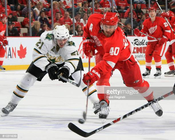 Henrik Zetterberg of the Detroit Red Wings shoots the puck while Loui Eriksson of the Dallas Stars defends against him during game one of the Western...
