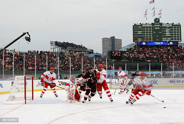 Henrik Zetterberg of the Detroit Red Wings skates after the puck during the NHL Winter Classic at Wrigley Field on January 1 2009 in Chicago Illinois