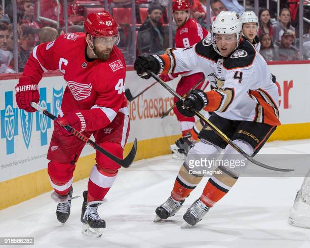Henrik Zetterberg of the Detroit Red Wings skates around the net next to Cam Fowler of the Anaheim Ducks during an NHL game at Little Caesars Arena...