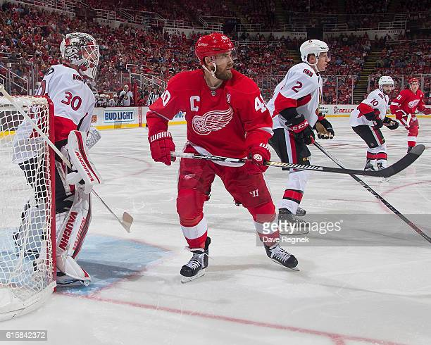 Henrik Zetterberg of the Detroit Red Wings skates in front of Andrew Hammond of the Ottawa Senators during an NHL game at Joe Louis Arena on October...