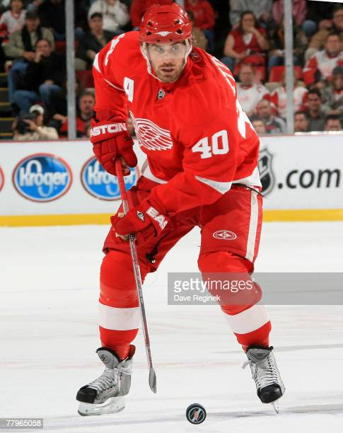 Henrik Zetterberg of the Detroit Red Wings skates up ice with the puck during an NHL game against the Chicago Blackhawks at Joe Louis Arena November...