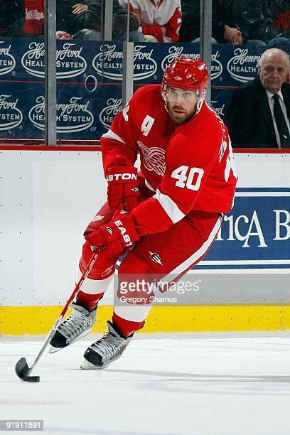 Henrik Zetterberg of the Detroit Red Wings skates with the puck during the game against the Washington Capitals on October 10 2009 at Joe Louis Arena...