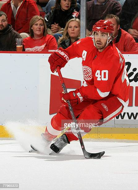 Henrik Zetterberg of the Detroit Red Wings stops with the puck during an NHL game against the Chicago Blackhawks at Joe Louis Arena November 17 2007...