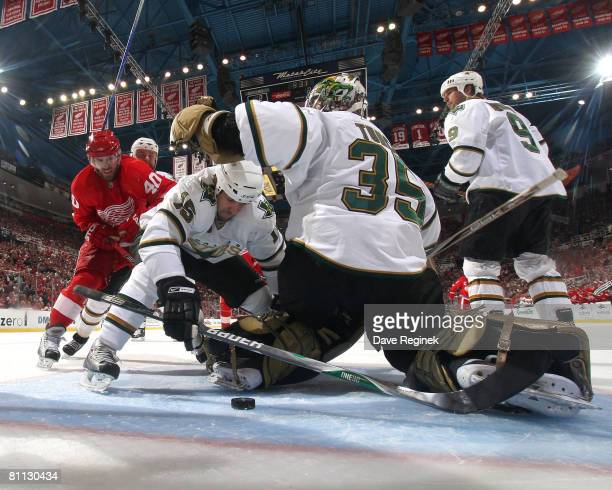 Henrik Zetterberg of the Detroit Red Wings tries to make his way past the mob of Dallas Stars to get to the loose puck during game five of the...