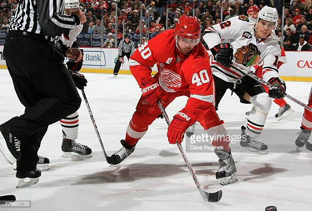Henrik Zetterberg of the Detroit Red Wings wins the face off during an NHL game against the Chicago Blackhawks at Joe Louis Arena November 17 2007 in...