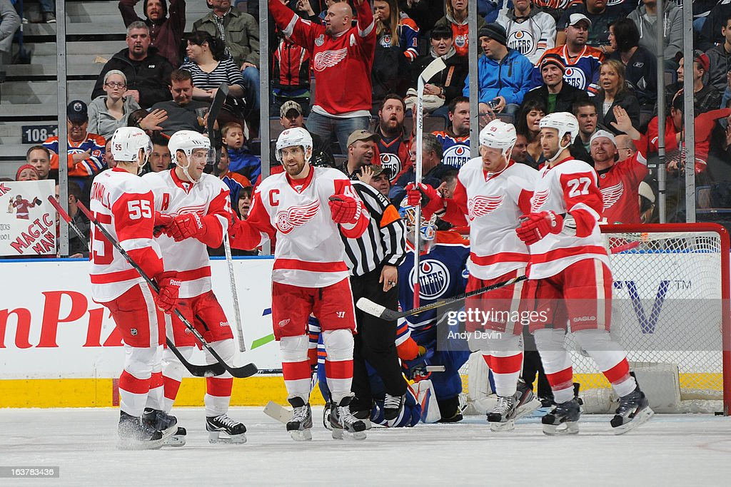 Henrik Zetterberg #40, Pavel Datsyuk #13, Niklas Kronwall #55, Johan Franzen, and Kyle Quincey of the Detroit Red Wings celebrate after a goal against the Edmonton Oilers on March 15 2013 at Rexall Place in Edmonton, Alberta, Canada.